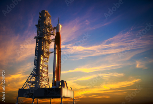 Fotografie, Obraz  Space Launch System On Launchpad Over Background Of Red Clouds