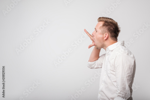 Caucasian man making bla bla sign with his hand. Empty promises. Tablou Canvas