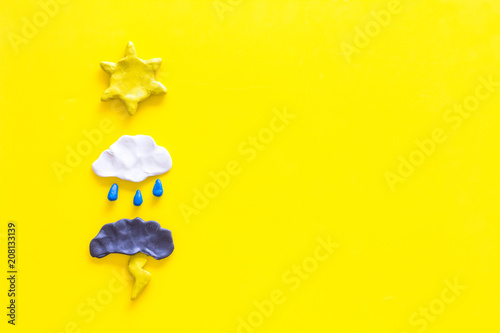 Obraz Weather forecast concept. Modern weather icons set on yellow background top view copy space - fototapety do salonu