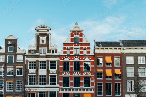 Fototapeta premium Beautiful Architecture Of Dutch Houses On Amsterdam Canal In Autumn
