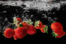 Strawberries Falling Into The ...