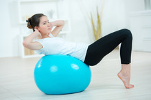 Young Woman Exercising Using A...