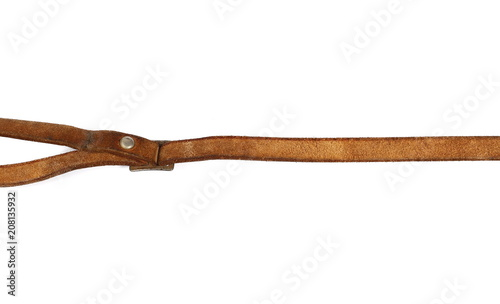 Fotomural  Old, brown leather belt, strap isolated on white background