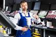 Mechanic pouring paints in paint-spray gun
