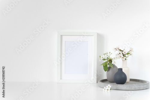 Canvas Prints Textures White frame mockup with spring cherry bouquet on concrete tray. Mock up for your photo, design or text.
