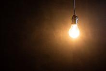 Brightness Tungsten Light Bulb Hanging At Dark Room