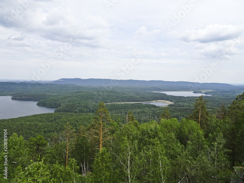 Fotobehang Wit Summer landscape: a view from the mountains of Shikhan