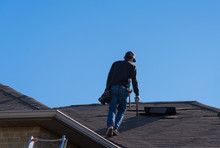 Worker Walking On A Damaged Roof