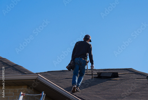 Fotografie, Obraz  Worker walking on a damaged roof