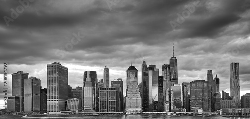 Fotobehang New York City Black and white Manhattan panoramic picture with stormy sky, New York City, USA.