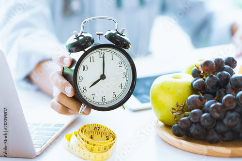 Fotografie, Obraz  Times to Healthcare or Diet Food advisor show clock for timing care your health with healthy food and concept