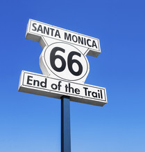 ROUTE 66, END OF THE TRAIL, ROAD SIGN IN SANTA MONICA PIER, LOS ANGELES, CALIFORNIA, UNITED STATES. SUNNY DAY, BLUE SKY, PACIFIC OCEAN.