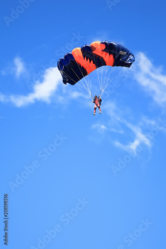 Fotografie, Obraz  Paratrooper with open parachute against blue sky