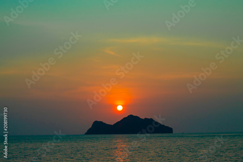 Spoed Foto op Canvas Zee zonsondergang Sunset Behind an Island in the Sea at Koh Phaghan in Suratthani Thailand.