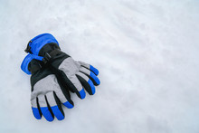 Blue And Gray Modern Skiing Gloves On Mountain White Snow