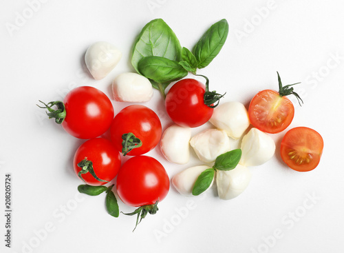 Garden Poster Food Ripe red tomatoes, mozzarella cheese balls and basil on white background, top view