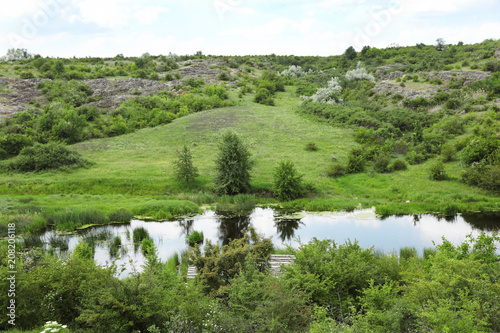 Foto op Canvas Pistache Beautiful landscape with beautiful pond and rocky hill. Camping season