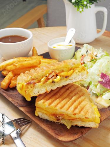Grilled cuban sandwich with ham, cheese, pickle, and mustard. Slika na platnu