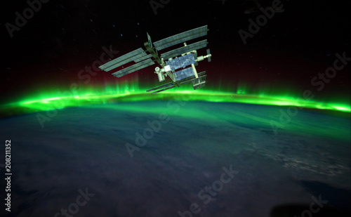 Photo  Space Station, Aurora above the Earth