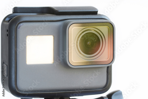 Black action camera on white background. Poster