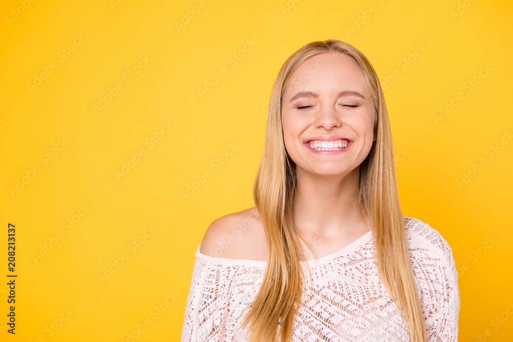 Fototapety, obrazy: Portrait with copy space empty place of comic funky girl laughing with clenched teeth keeping eyes closed isolated on yellow background