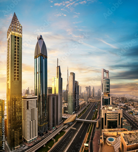 Fotobehang Stad gebouw Dubai downtown sunset panoramic view with modern skyscrapers.
