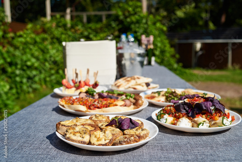 Plates With Snacks On Servered Buffet Table At Wedding Reception