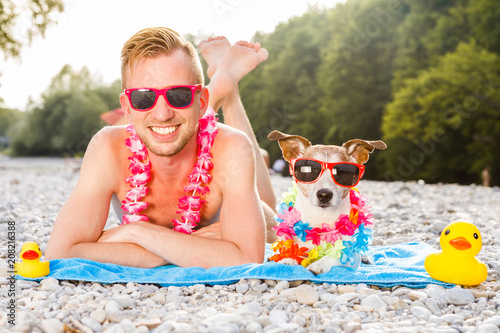 Foto op Plexiglas Crazy dog dog and owner at the beach
