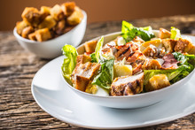 Delicious Salad Caesar With Grilled Chicken Breast Croutons Eggs Bacon Parmesan Cheese And  Lettuce With Dressing