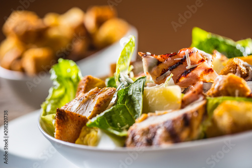 Fotomural Delicious salad caesar with grilled chicken breast croutons eggs bacon parmesan