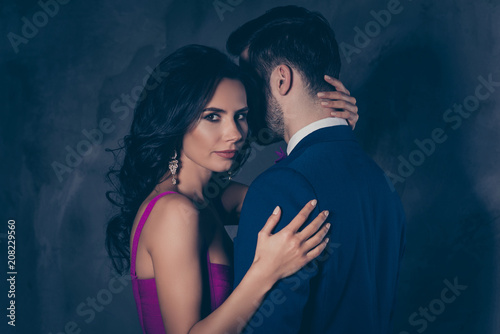 Fototapeta Portrait of beautiful pretty charming woman with curls looking at camera touching mysterious man with bristle in tux isolated on grey background, feminism adultery posh evening concept obraz na płótnie