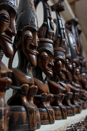 Traditional carving old man of Batak sold as souvenir to tourist in Samosir Isla Canvas Print