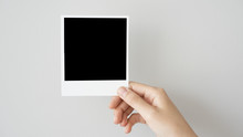 Hand Holding Blank Photo Frame