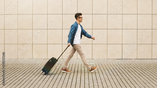 man with suitcase in the airport departure with a travel concept, summer vacation concept.
