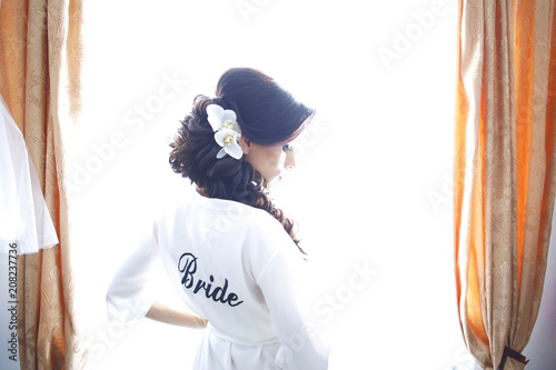 Fotografie, Obraz  Beautiful lady posing in robe at window