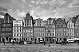 Central market square in Wroclaw Poland with old houses, street lamp and walking tourists people at gorgeous stunning evening sunset sunshine. Travel vacation concept. Black and white - 208241374