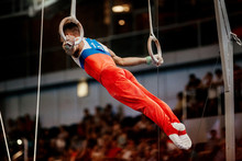 Artistic Gymnastics Men Gymnast Exercises On Still Rings