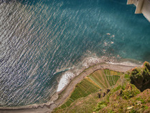 View On Winding Coastal Street Adjacent Beach With Atlantic Ocean Rollers Arrive At Beach Several Hundred Meter Below Cabo Girão On The Island Of Madeira