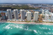 Aerial View Of North Miami Beach Skyscrapers With Sun And Clouds