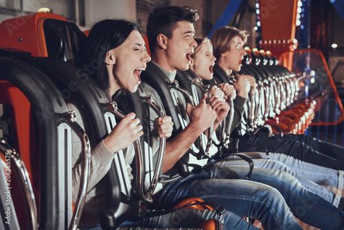 Wall Murals Amusement Park Image of shocked excited four friends