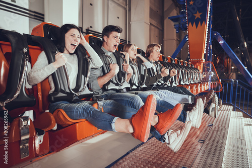 Young people are shocked by the speed of the carousel.