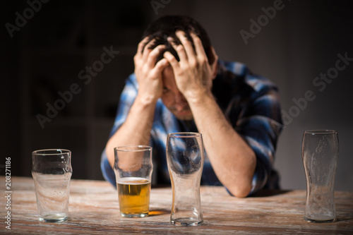 alcoholism, alcohol addiction and people concept - male alcoholic drinking beer Canvas Print