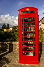 British Telephon Box Full Of Books In Barga, Italy