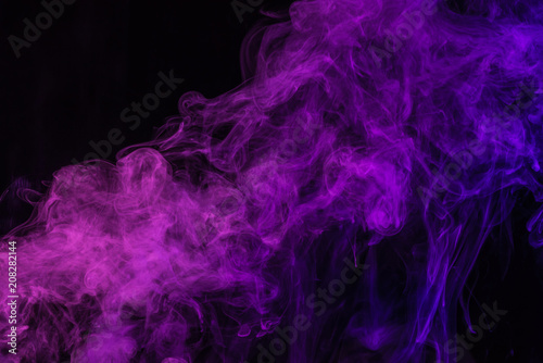 mystical purple smoke on black background
