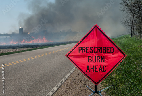 Prescribed Agricultural Burn Area and Sign:  A sign warns motorists of a controlled burn area ahead on a farm in southern Wisconsin Fototapet