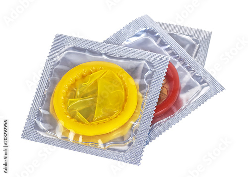 Foto Three colored condoms isolated on a white background