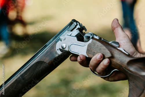 Stampa su Tela discharged shotgun bent male hand fingers gunpowder