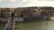 Rome panorama as seen from Castel Sant Angelo. Summer day. Europe Italy. Scenery. Green waters of the Tiber. Locked down real time medium shot