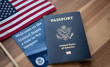 Leinwandbild Motiv Passport of USA (United states of America) next to a Guide for new Immigrants - Welcome to the United states and American Flag. Wooden Background.