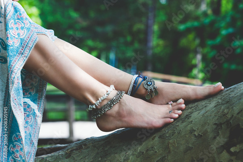 woman summer boho fashion style details on barefoot anklets and rings outdoor Canvas Print